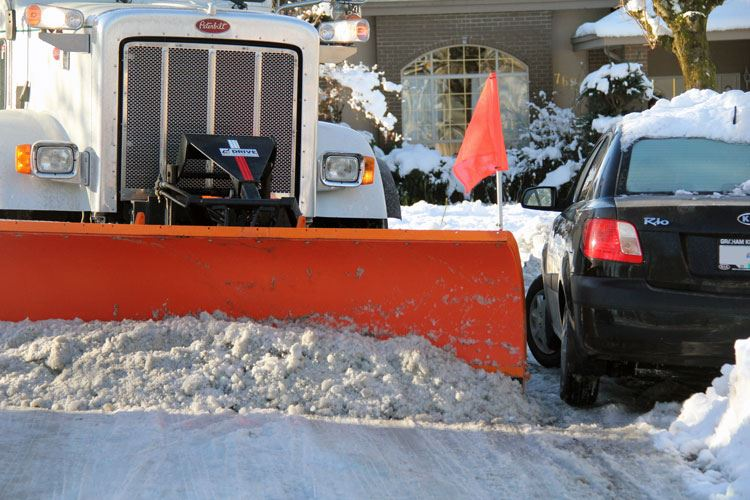 Snow Plow Parked Car